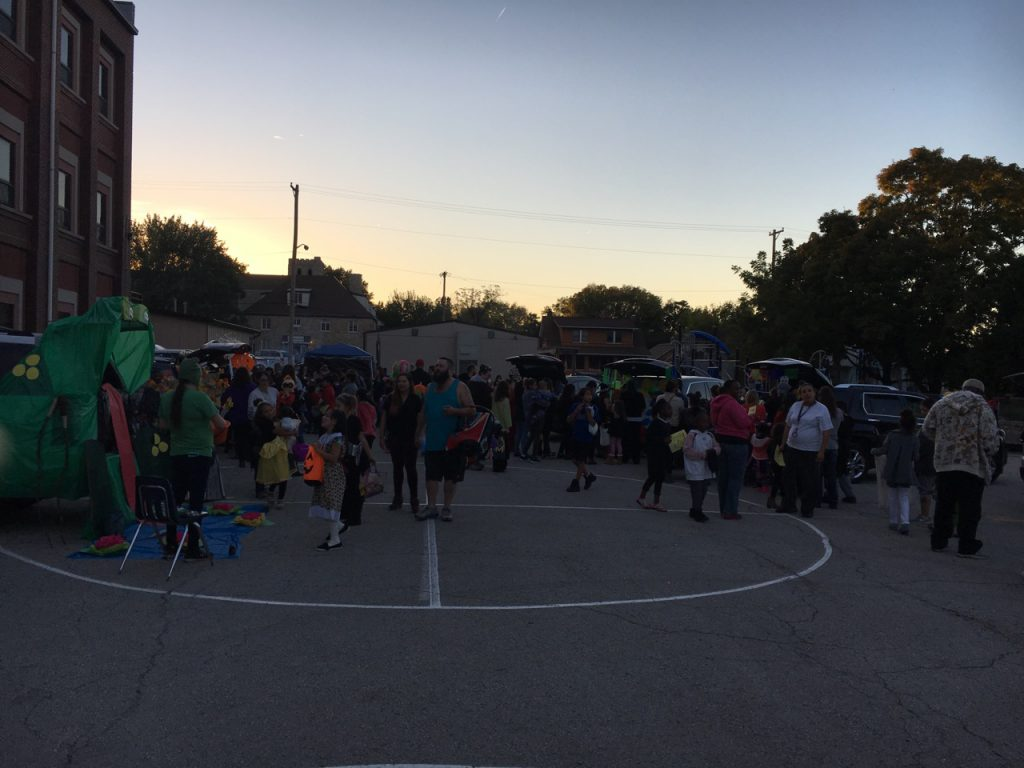 Students, families, and staff having fun at the PTA's Trunk or Treat!