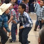 2nd Graders square dance at their fall program.