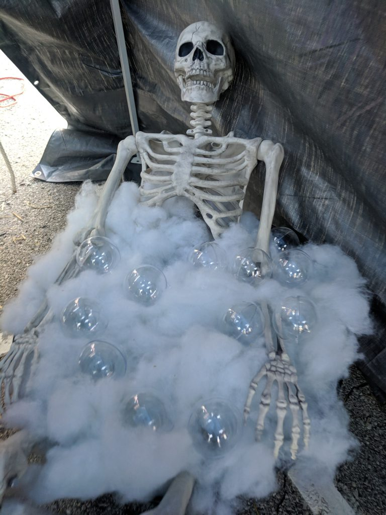 A skeleton taking a bubble bath.
