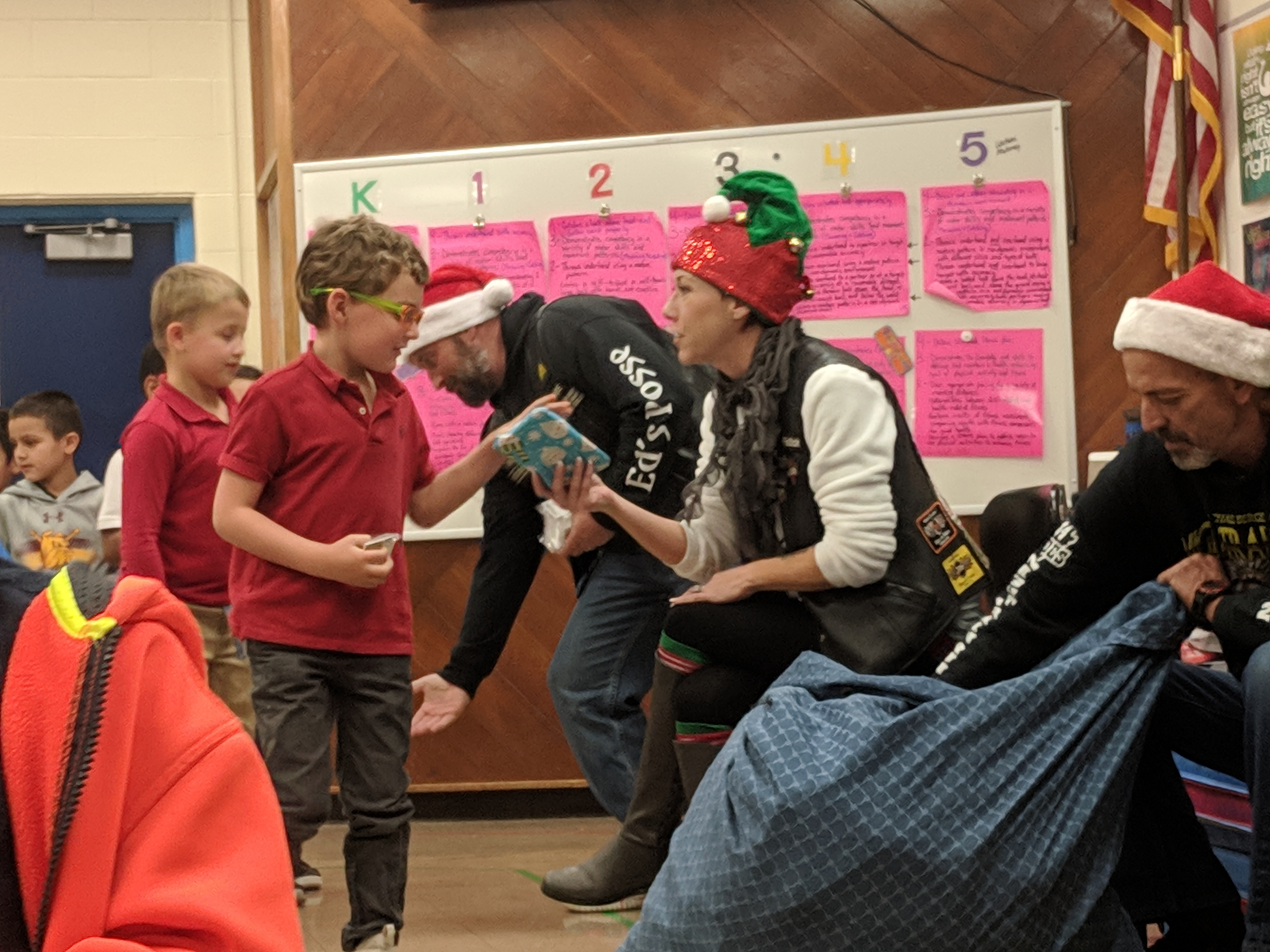 Hands to Hearts surprises Kindergartener & 1st Grade students with a holiday gift! Photo Credit: Ms. Quaas