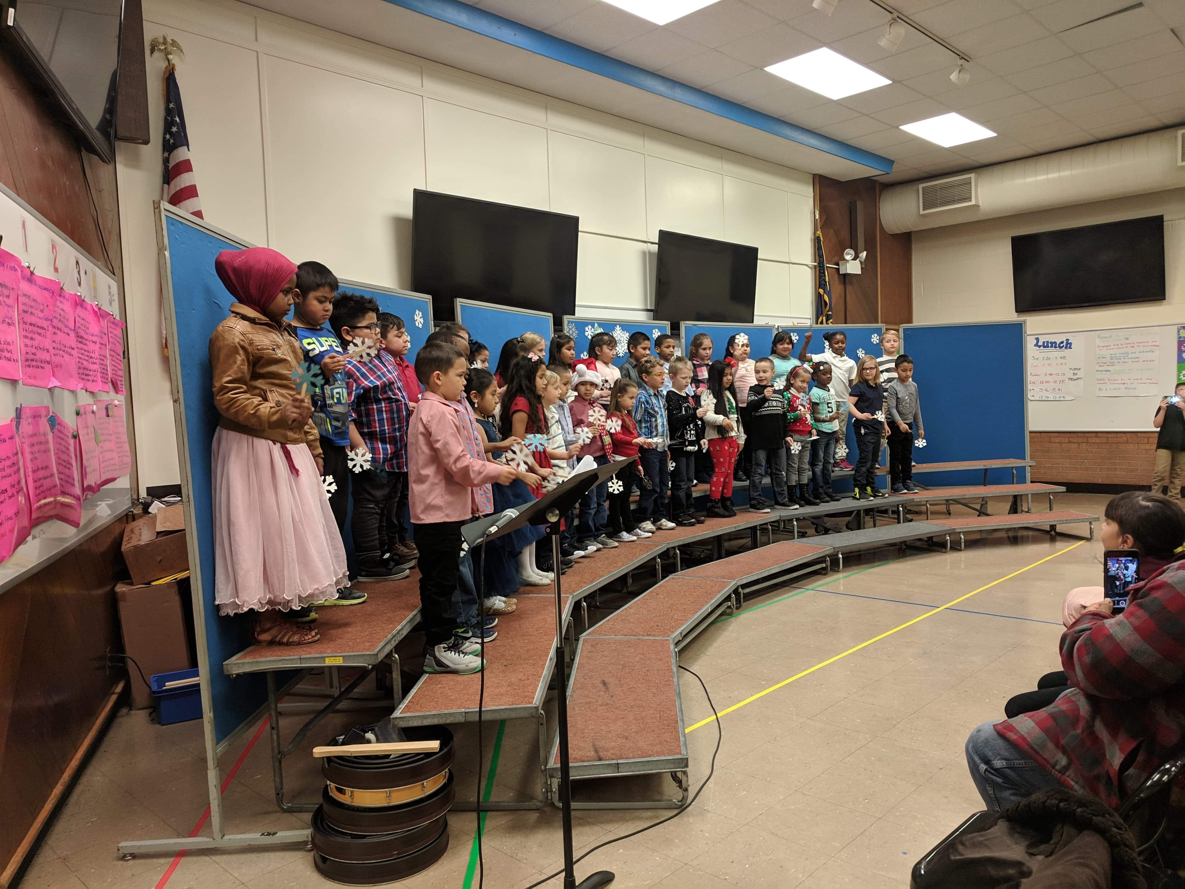 First Graders preform in their Winter Performance directed by Ms. Murray. Photo Credit: Mrs. Everest